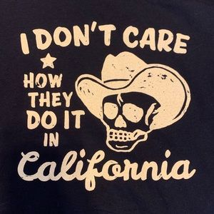 Tops - I Don't Care Texas Big D babydoll tee